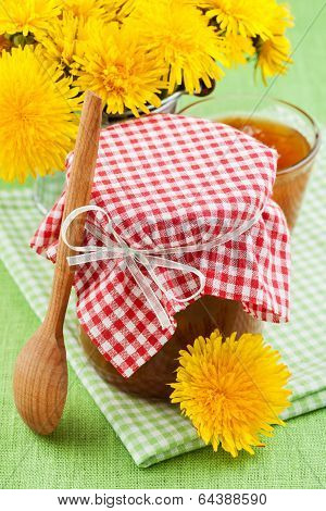 Jar Of Dandelion Jam And Blowball Flowers