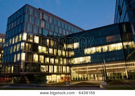 Complex Of Office Buildings From Glass In The Evening With The Windows