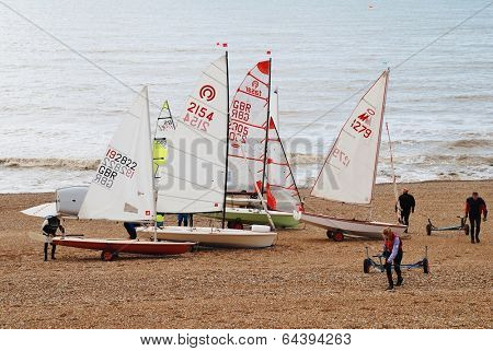 ST.LEONARDS-ON-SEA, ENGLAND - MARCH 23, 2014: Sailing dinghies of the Hastings and St.Leonards Sailing Club ready for launch from the shingle beach. The present day club was founded in 1953.