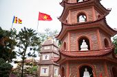 pic of trans  - The Buddhist pagoda and Vietnam flag in Hanoi, Vietnam.