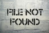 pic of not found  - file not found black stencil print on the grunge brick wall - JPG