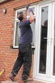 picture of windows doors  - A Window fitter removing old windows and doors in preparation for new plastic ones to be fitted - JPG