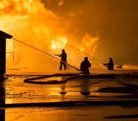 pic of firemen  - Firemen at work on fire - JPG