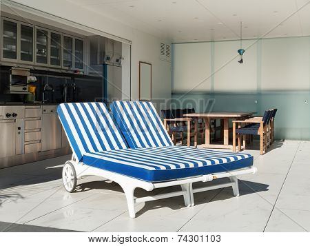 Architecture,  terrace of a penthouse, two sunbed outside