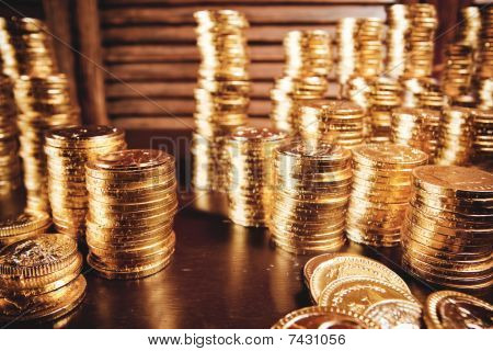 golden coins in wooden table