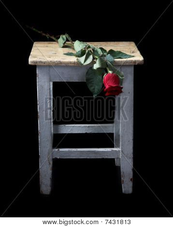 Flowers And Old A Stool