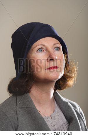 Brunette In Blue Cloche Hat Looking Up