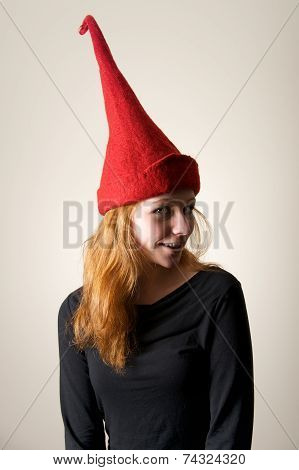 Redhead In Red Pointed Hat Turning Head