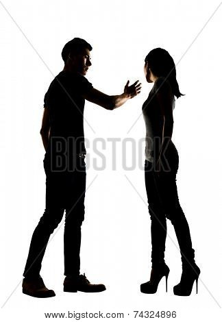 Silhouette of a man slapping a woman depicting domestic violence, full length isolated on white.