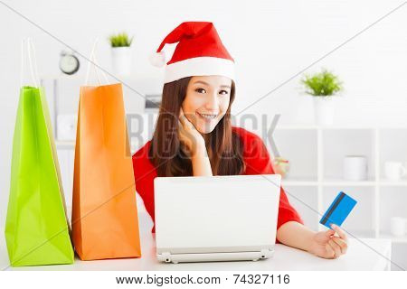 Beautiful Young Woman Holding Credit Card With Laptop. Christmas Shopping Concept..