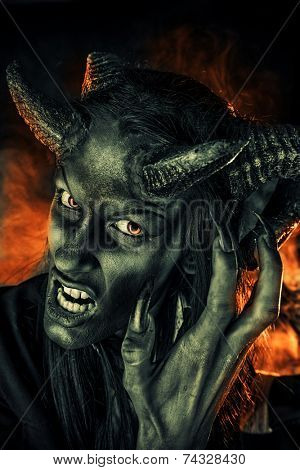Portrait of a devil with horns. Fantasy. Art project.