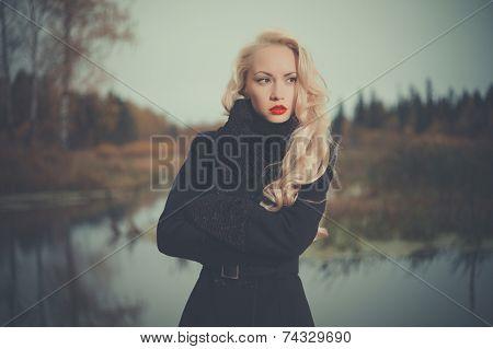 Beautiful Elegant Woman In A Black Coat