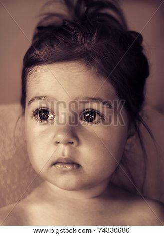 toned portrait of Cute sad kid thinking
