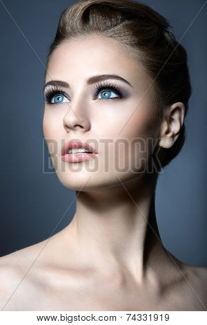 Beautiful young girl with a light natural make-up. Beauty face.