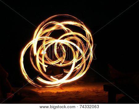 Fire Juggler In Full Swing