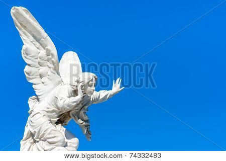 Beautiful angel with a clear blue sky background with space for text