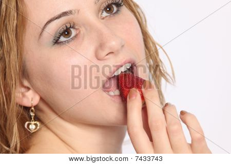 Beautiful Woman Eating Strawberry