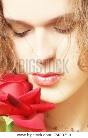 Sensitive Woman With Red Rose
