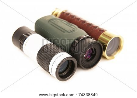 Modern monocular telescopes isolated on white