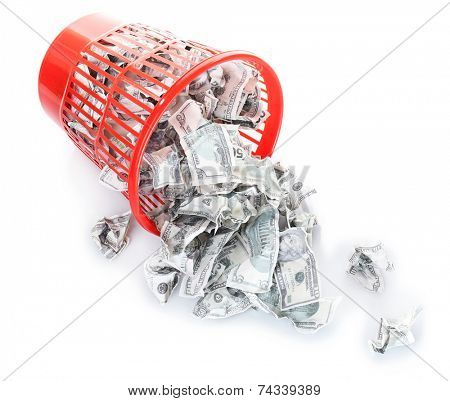 Money in dustbin isolated on white