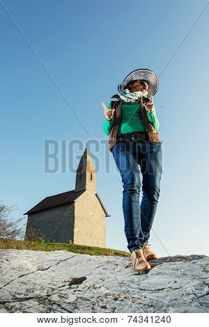 Young Brunette In A Stylish Hat And An Old Romanesque Church Archangel Michael