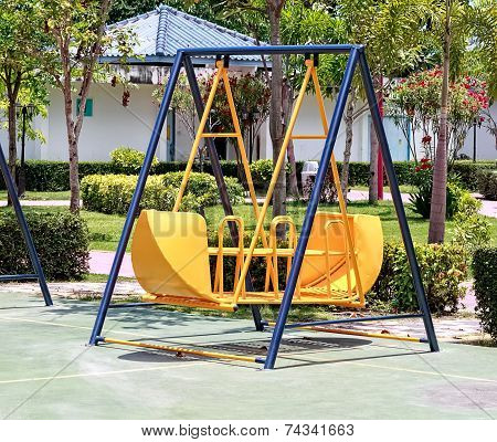 Yellow Swing In Children Playground