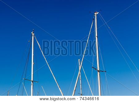 Detail Shot Of Sailing Boat Poles (mainmasts) In Marina.