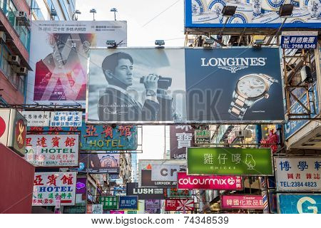 HONG KONG , CHINA - AUG 10 : Mongkok  on August 10, 2014 in Hong Kong, China. Mongkok in Kowloon is one of the most neon-lighted place in the world and is full of ads of different companies.