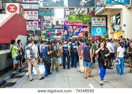 HONG KONG , CHINA - AUG 10 : Mongkok shopping street on August 10, 2014 in Hong Kong, China. Mongkok in Kowloon is one of the most neon-lighted place in the world and is full of ads of  companies.