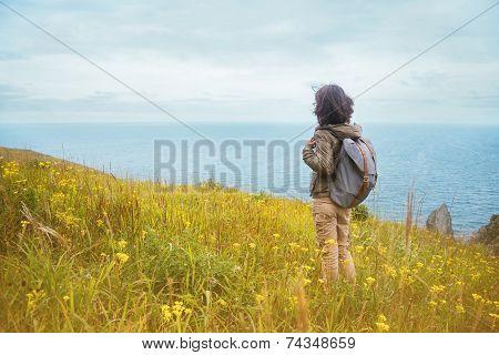 Hiker Woman Looks On The Sea