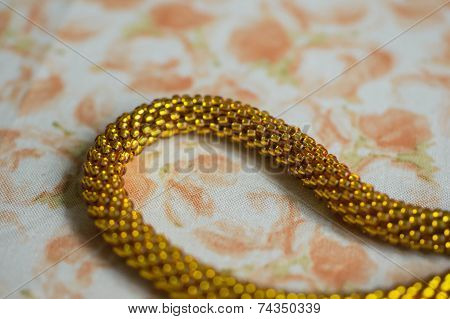 Fragment Of A Necklace From Beads On A Textile Background