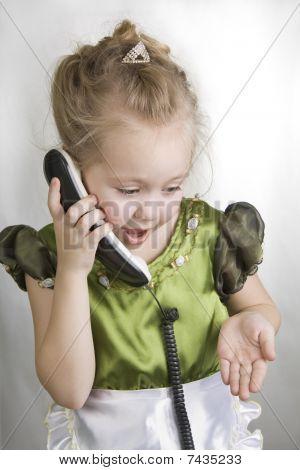 Little Girl Speaks On The Telephone.