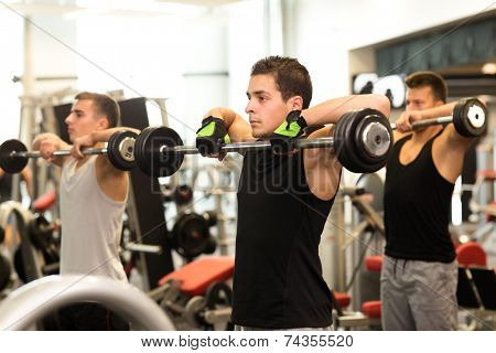 sport, fitness, lifestyle and people concept - group of men with barbells in gym