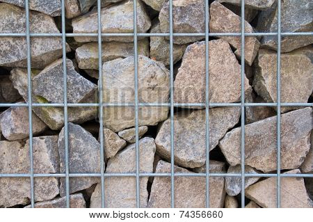 gabion wall filled with broken limestone