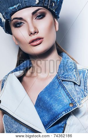 Sexy Woman In Denim Waistcoat And Blue Hat