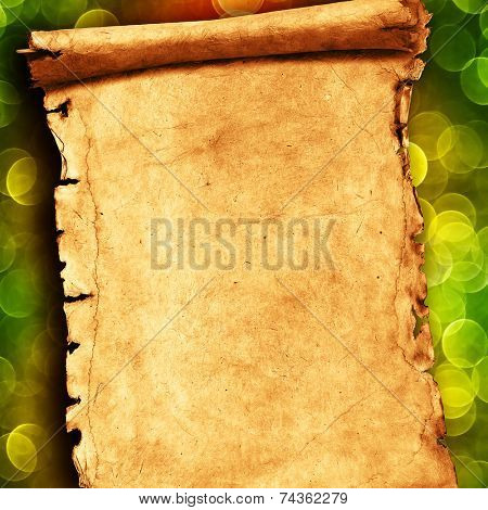 Colorful abstract background with Christmas lights and paper scroll.