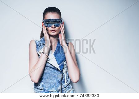Woman In Denim Costume And Denim Sunglasses