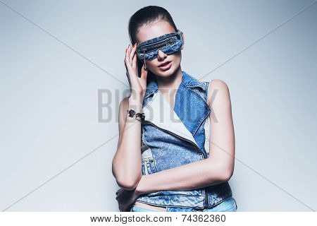 Woman In Denim Waistcoat And Sunglasses