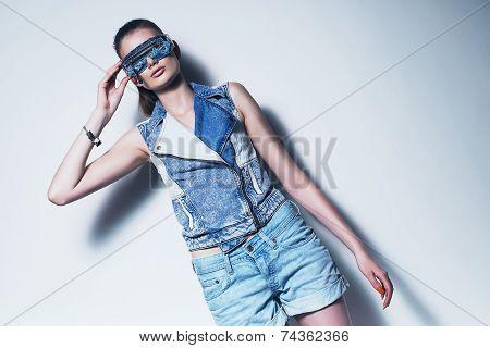 Woman In Sunglasses And Denim Waistcoat
