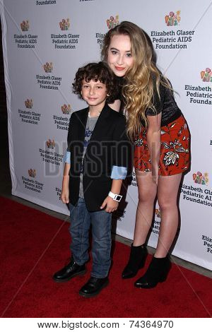 LOS ANGELES - OCT 19:  Sabrina Carpenter, August Maturo at the 25th Annual