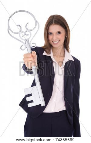 Successful young businesswoman holding a key: concept for success ar career.