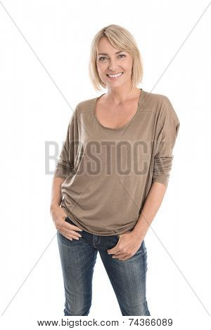 Happy middle age blond woman in blue jeans isolated over white.