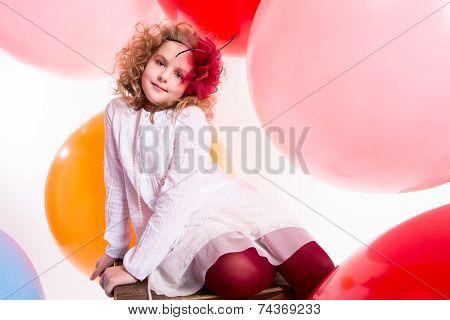Happy Joyful Beautiful Girl On A Background Of The Larger Balls