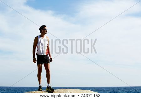 Fit man enjoying the sun listen the music, freedom concept