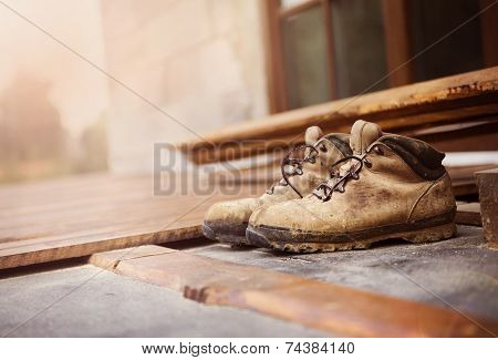 Worker boots on unfinished flooring