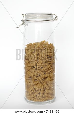 Wholegrain pasta in a glass jar