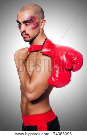 Badly beaten boxer isolated on white