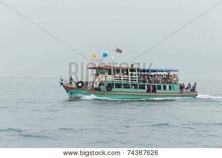 Pattaya, Thailand - January 14, 2012: The pleasure craft with passengers onboard