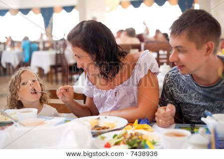 young caucasian family having dinner together.