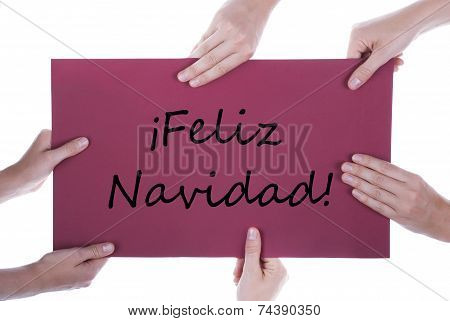 Hands Holding Sign With Feliz Navidad